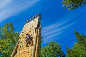 Student ascends the climbing tower